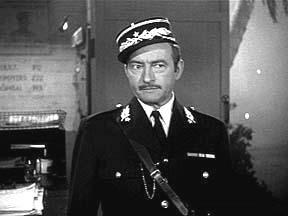Claude Rains as Captain Louis Renard